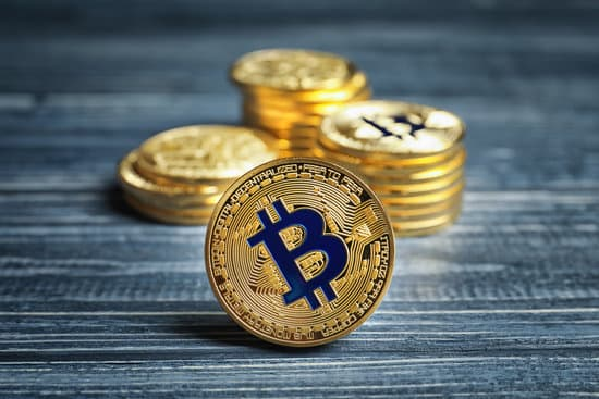 Golden bitcoin on wooden background