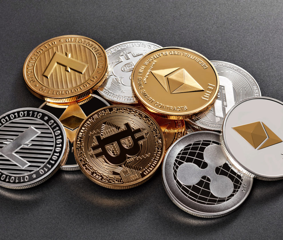 Different coins of crypto currency on a dark background